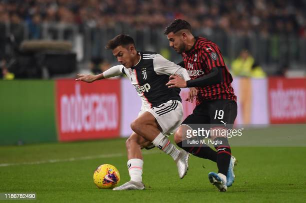 Paulo Dybala of Juventus is challenged by Hernandez Theo of Milan during the Serie A match between Juventus and AC Milan at Allianz Stadium on...