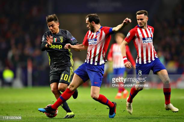 Paulo Dybala of Juventus is challenged by Juanfran of Club Atletico de Madrid during the UEFA Champions League Round of 16 First Leg match between...