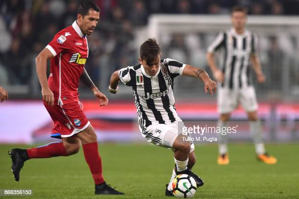 Paulo Dybala of Juventus is challenged by Marco Borriello of Spal during the Serie A match between Juventus and Spal on October 25 2017 in Turin Italy