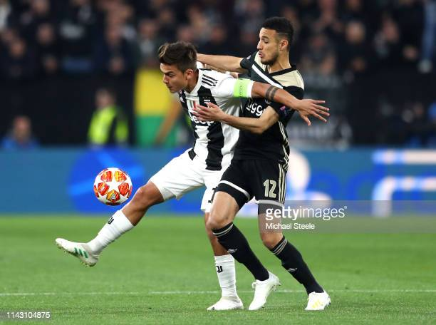 Paulo Dybala of Juventus is challenged by Noussair Mazraoui of Ajax during the UEFA Champions League Quarter Final second leg match between Juventus...