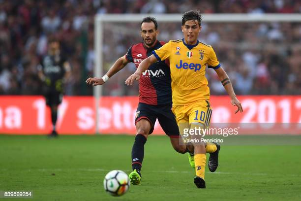 Paulo Dybala of Juventus is challenged by Santiago Gentiletti of Genoa CFC is challenged by during the Serie A match between Genoa CFC and Juventus...