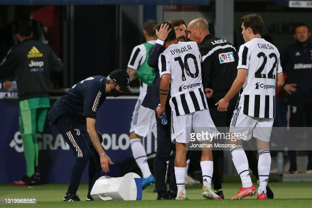 Paulo Dybala of Juventus is embraced by Andrea Pirlo Head coach of Juventus after his effort set up Federico Chiesa to open the scoring during the...