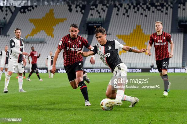 Paulo Dybala of Juventus is tackled by Ismael Bennacer of AC Milan during the Coppa Italia Semi-Final Second Leg match between Juventus and AC Milan...