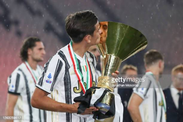 Paulo Dybala of Juventus kisses the scudetto following the Serie A match between Juventus and AS Roma at on August 01 2020 in Turin Italy