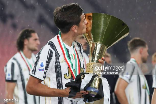Paulo Dybala of Juventus kisses the Scudetto following the Serie A match between Juventus and AS Roma on August 01 2020 in Turin Italy