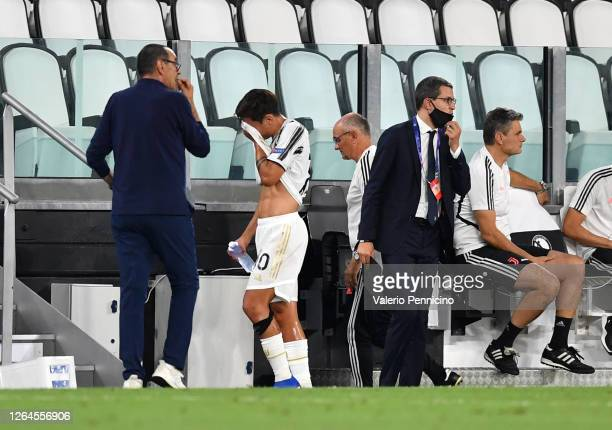 Paulo Dybala of Juventus leaves the pitch due to injury during the UEFA Champions League round of 16 second leg match between Juventus and Olympique...