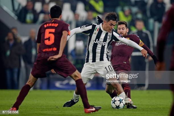 Paulo Dybala of Juventus Lionel Messi of FC Barcelona during the UEFA Champions League match between Juventus v FC Barcelona at the Allianz Stadium...