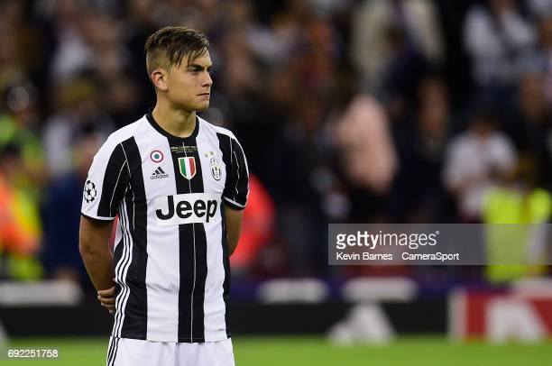 Paulo Dybala of Juventus looks dejected after his sides defeat during the UEFA Champions League Final match between Juventus and Real Madrid at...