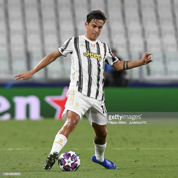 Paulo Dybala of Juventus picks up an injury during the UEFA Champions League round of 16 second leg match between Juventus and Olympique Lyon at...