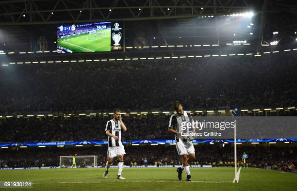Paulo Dybala of Juventus places the ball down for a corner during the UEFA Champions League Final between Juventus and Real Madrid at National...