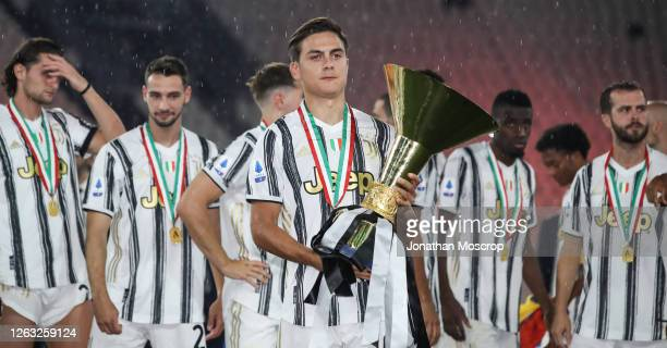 Paulo Dybala of Juventus poses with the scudetto following the Serie A match between Juventus and AS Roma at on August 01 2020 in Turin Italy