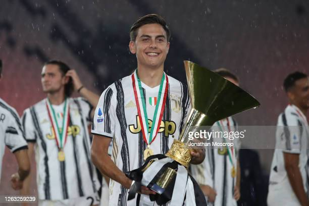 Paulo Dybala of Juventus poses with the trophy following the Serie A match between Juventus and AS Roma at on August 01 2020 in Turin Italy