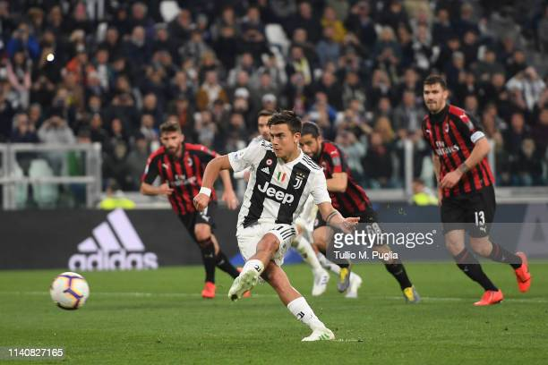 Paulo Dybala of Juventus scorea a penalty during the Serie A match between Juventus and AC Milan on April 06 2019 in Turin Italy