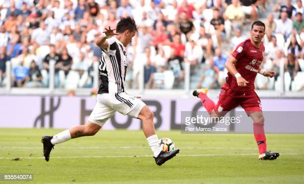 Paulo Dybala of Juventus scores his first goal during the Serie A match between Juventus and Cagliari Calcio at Allianz Stadium on August 19 2017 in...