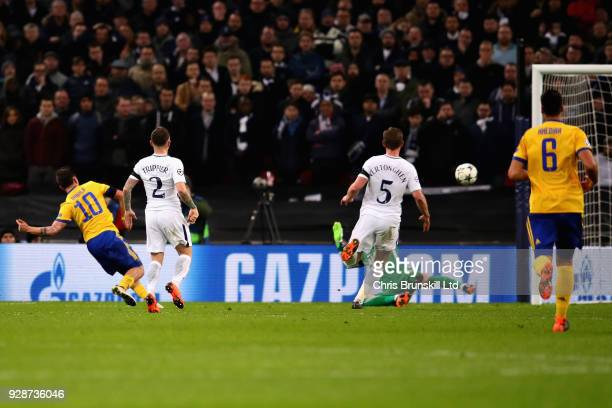 Paulo Dybala of Juventus scores his sides second goal during the UEFA Champions League Round of 16 Second Leg match between Tottenham Hotspur and...