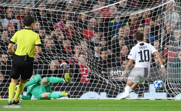 Paulo Dybala of Juventus scores his team's first goal during the Group H match of the UEFA Champions League between Manchester United and Juventus at...