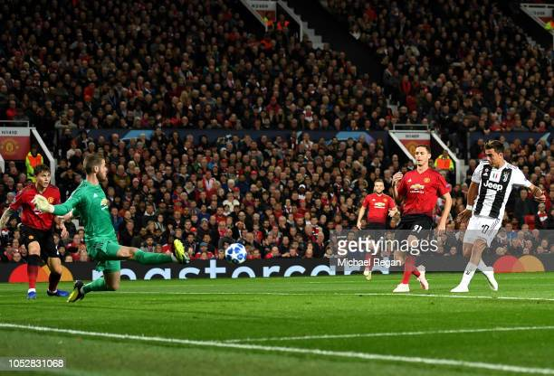 Paulo Dybala of Juventus scores his team's first goal past David De Gea of Manchester United during the Group H match of the UEFA Champions League...