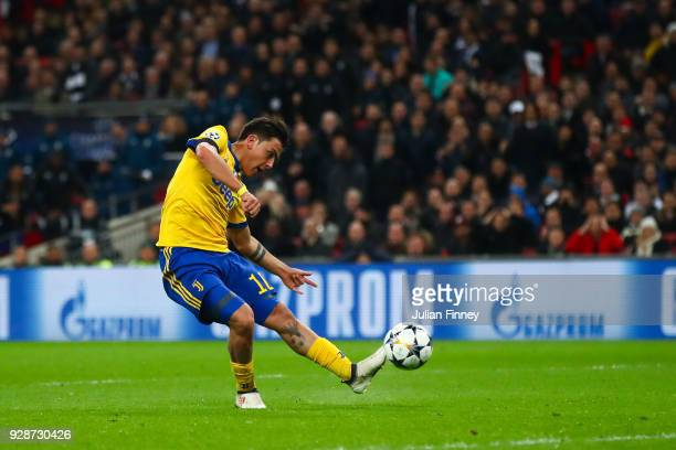 Paulo Dybala of Juventus scores his team's second goal during the UEFA Champions League Round of 16 Second Leg match between Tottenham Hotspur and...