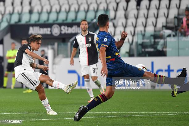 Paulo Dybala of Juventus scores the opening goal during the Serie A match between Juventus and US Lecce at Allianz Stadium on June 26, 2020 in Turin,...