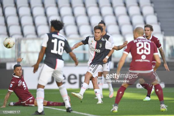 Paulo Dybala of Juventus scores the opening goal during the Serie A match between Juventus and Torino FC at Allianz Stadium on July 4, 2020 in Turin,...