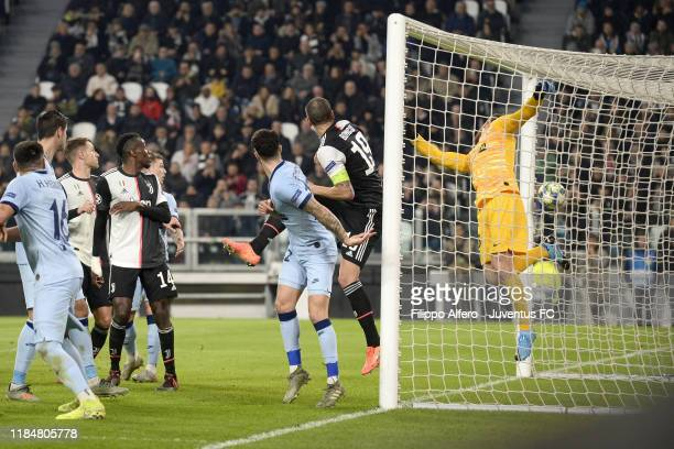 Paulo Dybala of Juventus scores the opening goal during the UEFA Champions League group D match between Juventus and Atletico Madrid at Allianz...