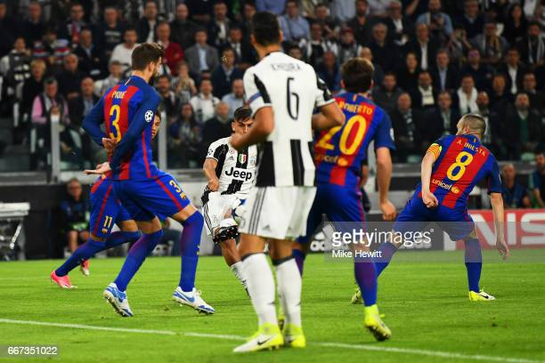 Paulo Dybala of Juventus scores the opening goal during the UEFA Champions League Quarter Final first leg match between Juventus and FC Barcelona at...