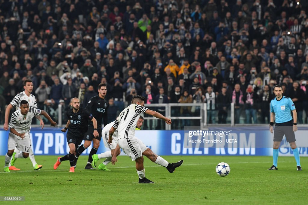 Paulo Dybala of Juventus scores the opening goal from the penalty spot during the UEFA Champions League Round of 16 second leg match between Juventus and FC Porto at Juventus Stadium on March 14, 2017 in Turin, Italy.