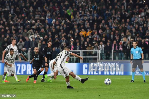 Paulo Dybala of Juventus scores the opening goal from the penalty spot during the UEFA Champions League Round of 16 second leg match between Juventus...