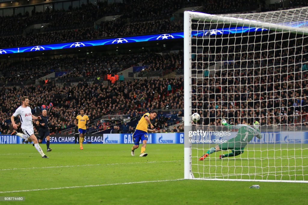 Paulo Dybala of Juventus scores their 2nd goal during the UEFA Champions League Round of 16 Second Leg match between Tottenham Hotspur and Juventus at Wembley Stadium on March 7, 2018 in London, United Kingdom.
