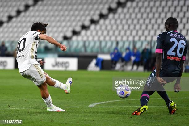 Paulo Dybala of Juventus scores their side's second goal whilst under pressure from Kalidou Koulibaly of Napoli during the Serie A match between...