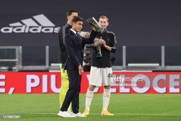 Paulo Dybala of Juventus shows off his Serie A player of the year award along with team mates Wojciech Szczesny and Dejan Kulusevski prior to the...