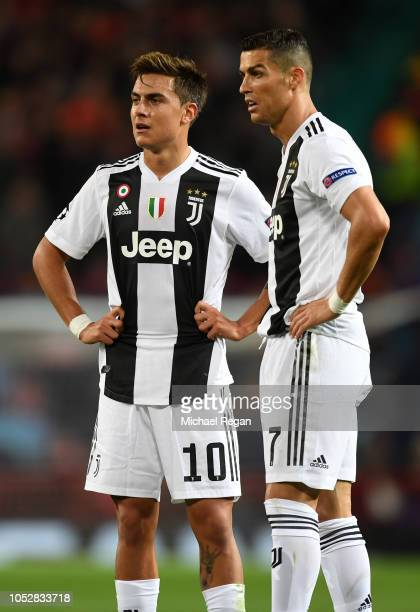 Paulo Dybala of Juventus speaks with Cristiano Ronaldo of Juventus during the Group H match of the UEFA Champions League between Manchester United...