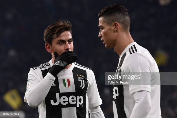 Paulo Dybala of Juventus speaks with his team mate Cristiano Ronaldo during the Serie A match between Juventus and Chievo at Allianz Stadium on...