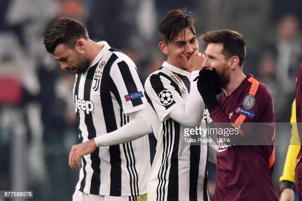 Paulo Dybala of Juventus speaks with Lionel Messi of Barcelona after the UEFA Champions League group D match between Juventus and FC Barcelona at...