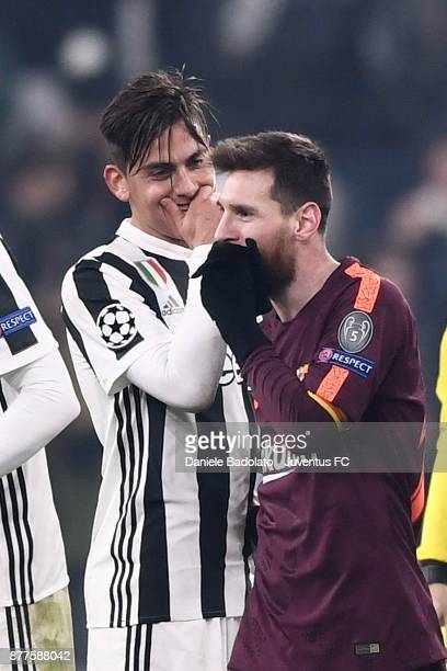 Paulo Dybala of Juventus speaks with Lionel Messi of Barcelona at the end of the the UEFA Champions League group D match between Juventus and FC...