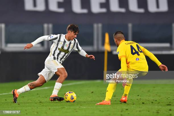 Paulo Dybala of Juventus takes on Andrea Carboni of Cagliari Calcio during the Serie A match between Juventus and Cagliari Calcio at on November 21,...