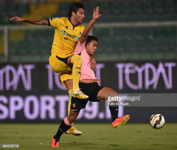 Paulo Dybala of Palermo and Davide Zoboli of Modena battle for the ball during the TIM Cup match between US Citta di Palermo v Modena FC at Stadio...