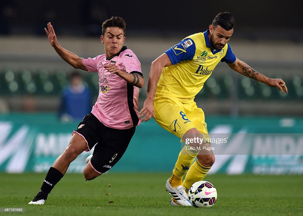 Paulo Dybala (L) of Palermo and Ervin Zukanovic of Chievo compete for the ball during the Serie A match between AC Chievo Verona and US Citta di Palermo at Stadio Marc'Antonio Bentegodi on March 21, 2015 in Verona, Italy.
