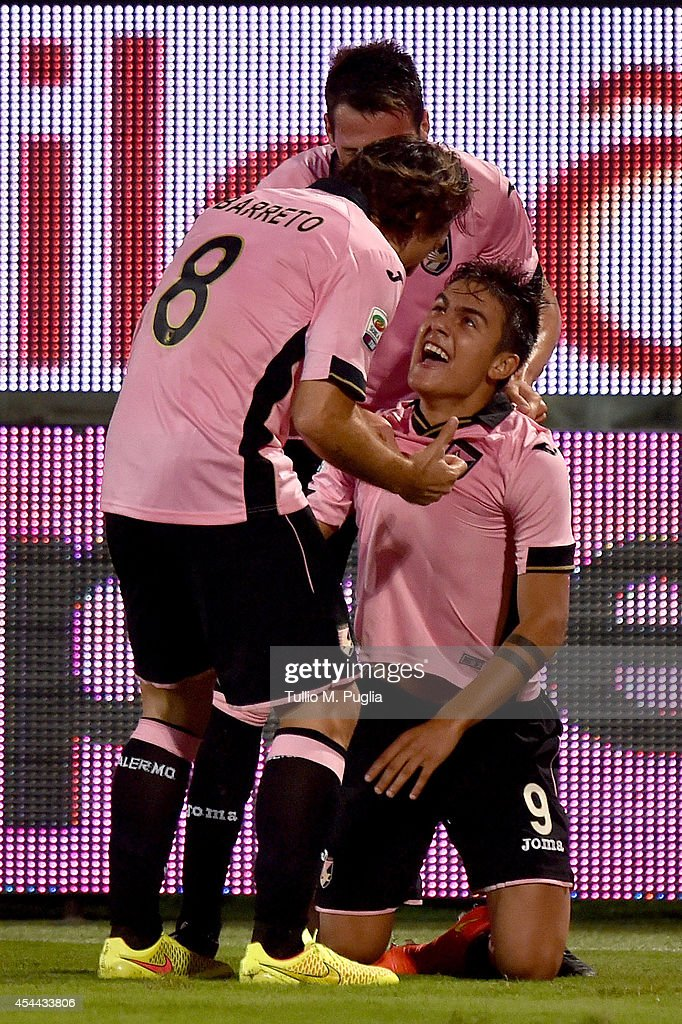 Paulo Dybala (R) of Palermo celebrates with Franco Vazquez and Edgar Barreto after scoring the opening goal during the Serie A match between US Citta di Palermo and UC Sampdoria at Stadio Renzo Barbera on August 31, 2014 in Palermo, Italy.
