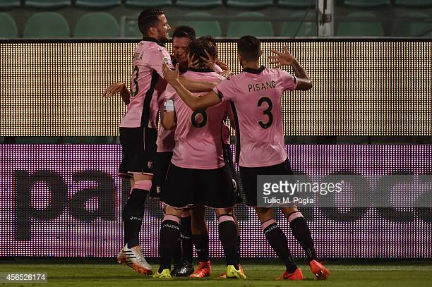 Paulo Dybala of Palermo celebrates with team mate after scoring the opening goal during the Serie A match between US Citta di Palermo and UC...