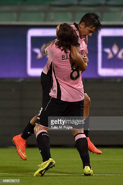 Paulo Dybala of Palermo celebrates with team mate Edgar Barreto after scoring the opening goal during the Serie A match between US Citta di Palermo...