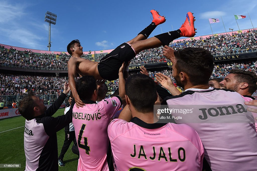 Paulo Dybala of Palermo is celebrated by team mates after the Serie A match between US Citta di Palermo and ACF Fiorentina at Stadio Renzo Barbera on May 24, 2015 in Palermo, Italy.