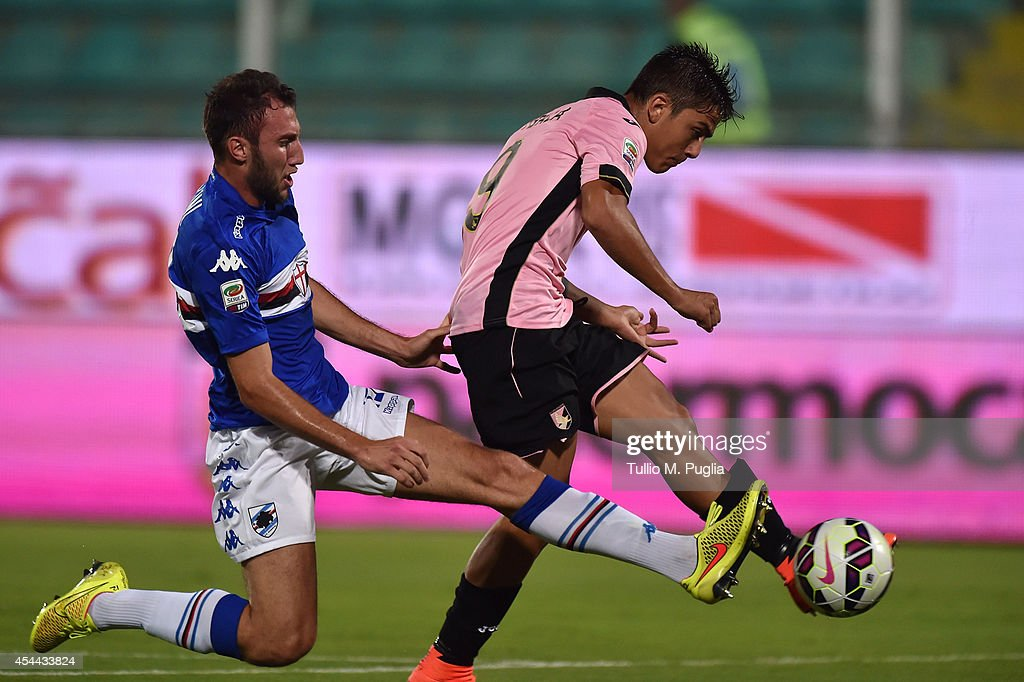 Paulo Dybala (R) of Palermo scores the opening goal during the Serie A match between US Citta di Palermo and UC Sampdoria at Stadio Renzo Barbera on August 31, 2014 in Palermo, Italy.