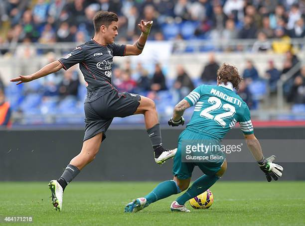 Paulo Dybala of US Città di Palermo and Federico Marchetti of SS Lazio in action during the Serie A match between SS Lazio and US Citta di Palermo at...