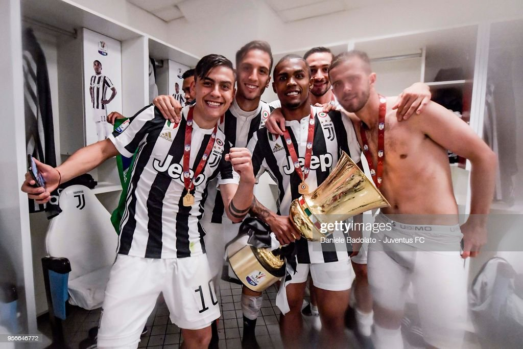 Paulo Dybala, Rodrigo Bentancur, Douglas Costa, Mattia De Sciglio and Miralem Pjanic of Juventus celebrate with the trophy after winning the TIM Cup Final between Juventus and AC Milan at Stadio Olimpico on May 9, 2018 in Rome, Italy.