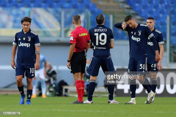 Paulo Dybala with his teammates of Juventus shows his dejection during the Serie A match between SS Lazio and Juventus at Stadio Olimpico on November...