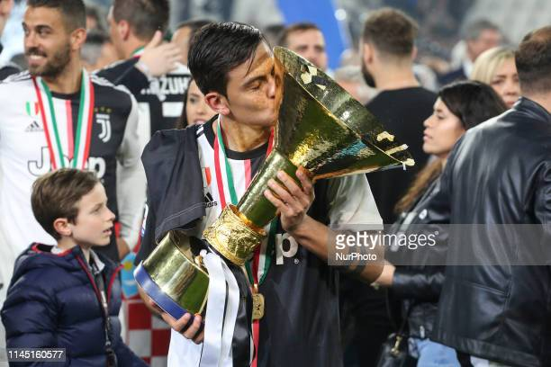 Paulo Dybala with the trophy of Scudetto during the victory ceremony following the Italian Serie A last football match of the season Juventus versus...