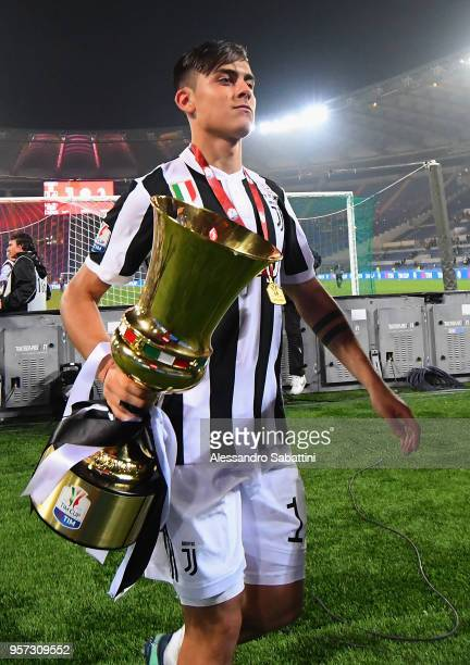 Paulo Exequiel Dybala of Juventus celebrates the victory after the TIM Cup Final between Juventus and AC Milan at Stadio Olimpico on May 9 2018 in...