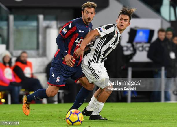 Paulo Exequiel Dybala of Juventus competes for the ball whit Federico Ceccherini of FC Crotone during the Serie A match between Juventus and FC...