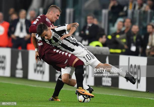 Paulo Exequiel Dybala of Juventus competes for the ball whit Evangelista Lyanco of Torino FC during the Serie A match between Juventus and Torino FC...